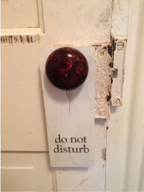 """Do not disturb"" sign on door knob"