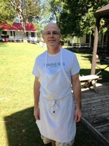 man in apron at Nimrod Hall