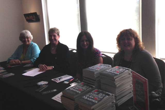 Suffolk Mystery Authors Festival table with Virginia is For Mysteries, Heather Weidner, Vivian Lawry, MARIA HUDGINS, TERESA INGE,