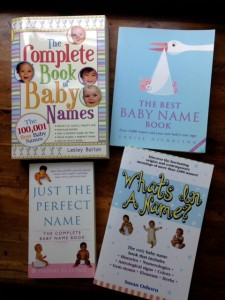 Book covers of four books on baby names you can use as character names