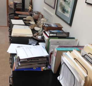 real writing space: a cluttered desk full of papers
