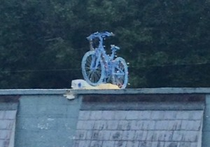 blue bicycle on top of dry cleaner in Ashland, Virginia