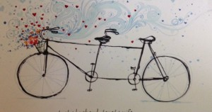 sketch of tandem bicycle surrounded by hearts