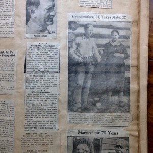 scrapbook pages with newspaper clippings
