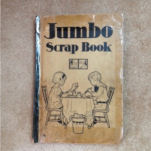 "scrapbook with sketch of boy and girl and text, ""Jumbo Scrap Book"""