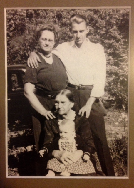 Vivian Lawry as a baby with her father, grandmother, and great-grandmother