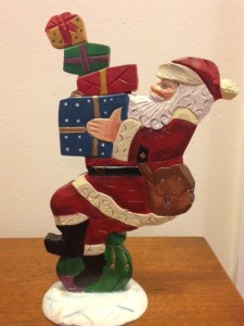 gift-giving-santa-figurine-with-stack-of-gifts