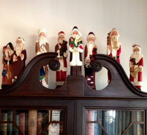 figurines of Santas around the world