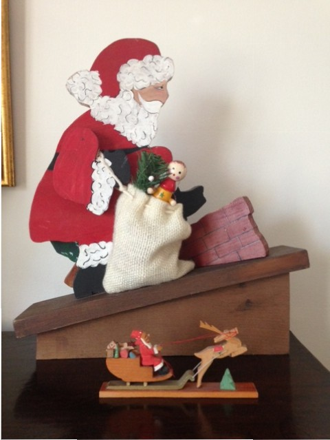 Santa Claus figurine entering chimney