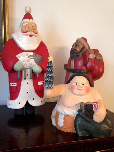 three Santa Claus figurines