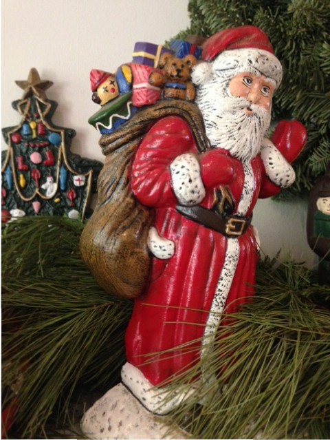 Santa Claus figurine on mantel