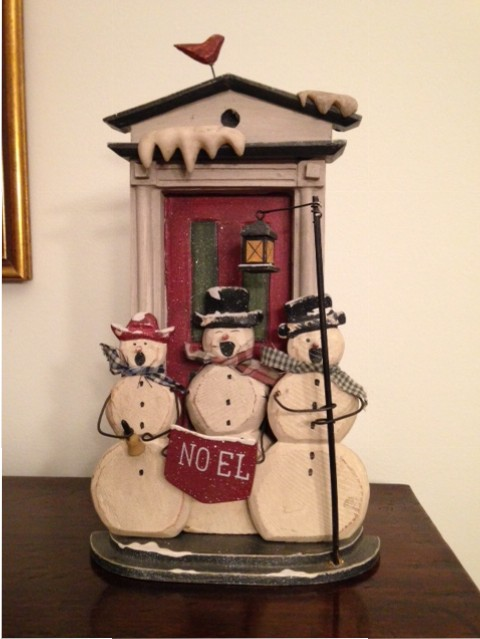 figurine of three snowmen caroling