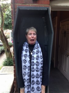 Vivian Lawry inside coffin at Poe Museum during Poe's Birthday Bash
