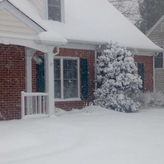 snow drifts by house