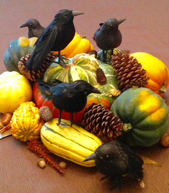 a murder of crows in an autumn centerpiece