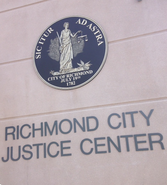 Richmond City Justice Center sign, city jail, creative writing about jail, creative writing about prison