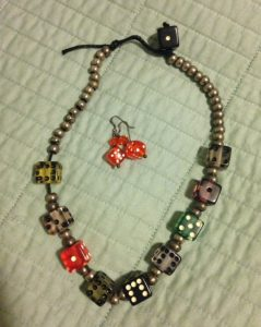necklace and earrings of dice, worn due to superstitions, Friday the 13th