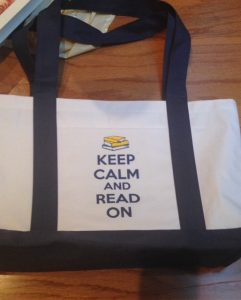 "Gaithersburg Book Festival tote bag reverse, blue text, ""Keep Calm and Read On"""