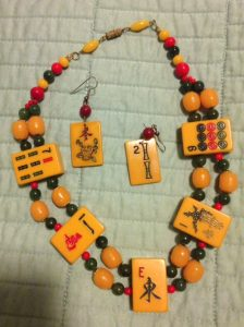 Necklace and earrings of mah jongg pieces, worn for superstitions