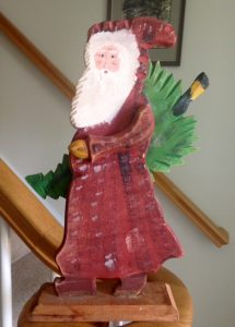 Wooden Santa carrying Christmas tree