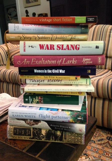 a stack of books is often a sign of book addiction