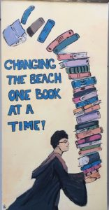 "illustration of Harry Potter carrying books ""Change the beach one book at a time"""