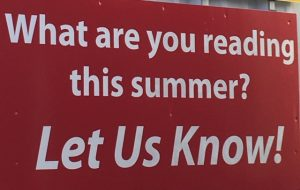 "beach reads sign: ""what are you reading this summer? Let us know!"""