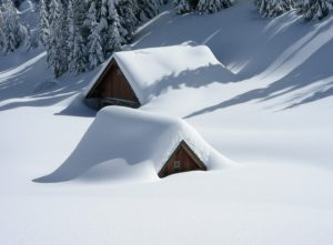 house capped in snow