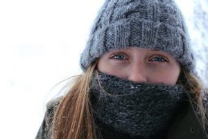 woman bundled against cold with scarf around face
